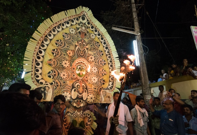 Kolam procession towards the temple.