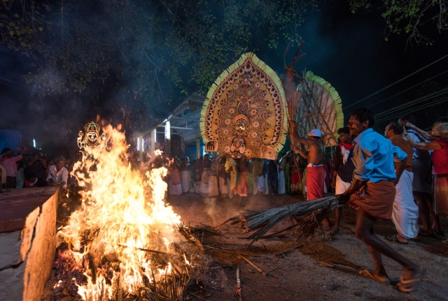 Bonfire and big kolam performance at the start of main event.
